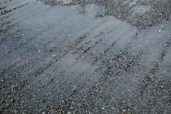 Flood after rain. Drain water on the gravel after hard rain Stock Photos