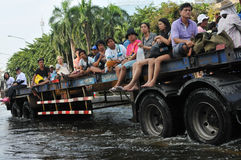 Flood Rescue. A lorry navigates a flooded road in Pinklao district in rescuing flood victims as Thailand faces its worst flooding in 50 years on November 4, 2011 Stock Photo