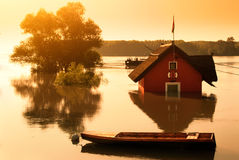 Flood river. Boat and house in flooding river Stock Photo