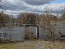 Flooded gazebo. Low cloud. Flood of the river. The flood of the river 2018. Flooded gazebo on the background of the river and low clouds royalty free stock image