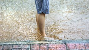 Flood on the road. And footpath in Thamai Chanthaburi Thailand Stock Photo