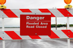 Flood Road Sign. A sign warning of danger due to flooded road after broken levy Stock Photo
