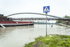 Flood. Sidewalk covered with water from the river in Krakow, Poland stock images