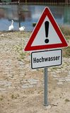Flood sign. German general warning sign and additional sign with german text for flood Stock Photography