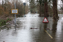 Flood sign in road Royalty Free Stock Photography
