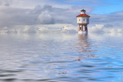 Flood simulation. Lighthouse and water tower at the island of Langeoog, Lower Saxony, Germany Stock Photos