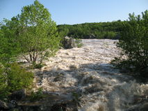 Flood Stage. Photo of the Potomac river at Great Falls Maryland during a spring flood stock photos