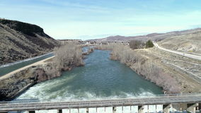 Almost flood stage water roars over Diversion Dam on Boise River stock video