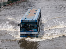 FLOOD THAILAND 2011. Bus navigating through the flood in Bangkok, Thailand Royalty Free Stock Photo