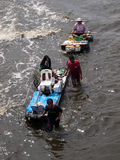 FLOOD THAILAND 2011. Man walk through the flood in Bangkok, Thailand Royalty Free Stock Image