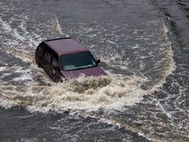 FLOOD THAILAND 2011. Cars navigating through the flood in Bangkok, Thailand Stock Image