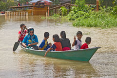 Flood Victims. Moving to evacuation center. Heavy rains cause irregular flood in Rantau Panjang, Malaysia - Thai borders