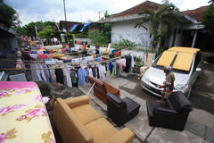 Flood Victims Expose Furniture. Residents sunning his furniture after floodwaters hit residential areas in Solo, Java, Indonesia. Access roads to the residential Stock Images