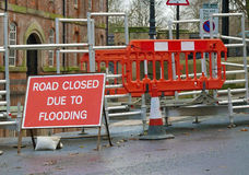 Flood walkway. YORK, NORTH YORKSHIRE, UK - Circa December 2015: Road close sign in front of pedestrian walkway crossing flooded water Stock Images