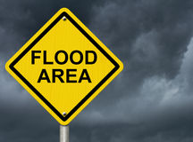 Flood Warning. A stormy sky with words Flood Area warning of flooding Royalty Free Stock Photos