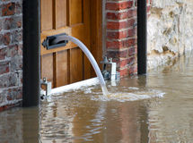 Flood water. Being pumped out of house in York, UK royalty free stock photo