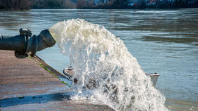 Flood water being pumped from pump station Royalty Free Stock Photo