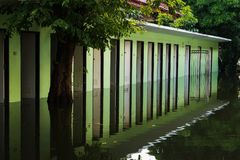 Flood water crisis from depression storm. Public toilets and bathrooms flooded after heavy rain caused from depression storm at the areas near Chao Phraya river Stock Photos