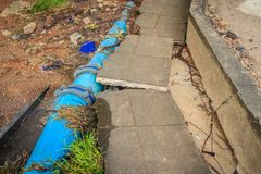 Flood water flow causing landslides and municipal water pipes ma Royalty Free Stock Photos