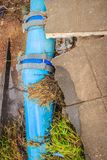 Flood water flow causing landslides and municipal water pipes ma Royalty Free Stock Image