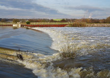 Flood water passing over a Weir Royalty Free Stock Photo