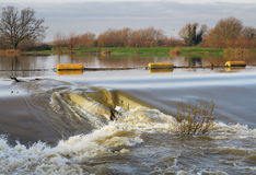 Flood water passing over a Weir Royalty Free Stock Photos