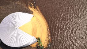 Agricultural farm silo burst open by Iowa State flood 2019. The flood water is receding after causing corn to expand and burst the farm silo holding it stock video