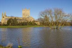 Flood water surrounding Tewksbury Abbey Royalty Free Stock Images