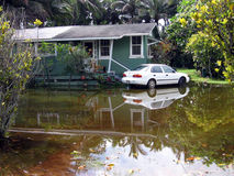 Flood Waters. Tropical House Surrounded By Flooding Water Stock Photos
