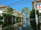 Flood waters overtake a house i. N Thailand stock photos