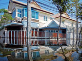 Flood waters overtake a house i Royalty Free Stock Images