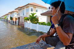 Flood waters overtake house in Thailand stock image
