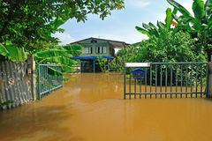 Flood waters overtake a house Royalty Free Stock Photo