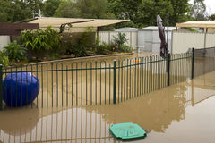 Flood waters. Pool area and pool covered by brown muddy flood waters Stock Photo