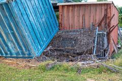 Flood Waters Pushed A Container On Its Side. A large storage container pushed onto it`s side by the force of flood waters royalty free stock photos