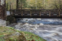 Flood waters rushing beneath a bridge in the Great Smoky Mountains. Horizontal aspect Stock Photography