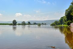 Flood on the Weser. Flood high water on the Weser. The river Weser has kicked metre high about the shores and has flooded everything. Here the river in the Stock Images