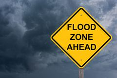Flood Zone Ahead Caution Sign. Storm Background stock photography