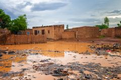 Flooded african slums. With lots of garbage during the rainy season july-august, Ouagadougou, Burkina Faso, West Africa stock photos