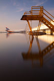 Flooded airport complex. Floodwaters submerge planes and buildings at Bangkok's Don Mueang Airport complex in Thailand Royalty Free Stock Photography