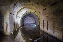 Flooded arced room at Object 221, abandoned soviet bunker, reserve command post of Black Sea Fleet Stock Photography