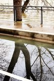 Flooding Seine River banks causes damage Paris. Flooded banks and the swollen Seine river. France on alert after days of heavy rains. Several areas on the Paris royalty free stock photos