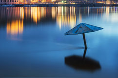 Flooded beach. Night scene with city lights and flooded beach in Kyiv, Ukraine Royalty Free Stock Photography