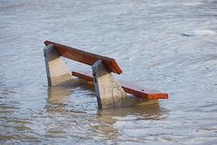 Flooded bench. The river Danube flooding in Budapest Stock Photography