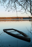 A flooded boat. A boat flooded beside a lakeside. Somewhere in the whild Leningrad region royalty free stock photo