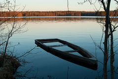 A flooded boat (landscape 2). A boat flooded beside a lakeside. Somewhere in the whild Leningrad region stock images