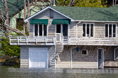 Flooded boathouse Stock Photo