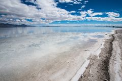 Surreal photo of flooded Bonneville Salt Flats in Toole County Utah. Flooded Bonneville Salt Flats in Utah create a mirror reflection scene on the water, looking royalty free stock image