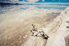 Flooded Bonneville Salt Flats in Utah create a mirror reflection scene on the water, looking surreal. Wide angle view of Bonneville Salt Flats in Utah create a royalty free stock photos