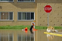 Flooded Building. And Local City Street. Flood Damage stock image